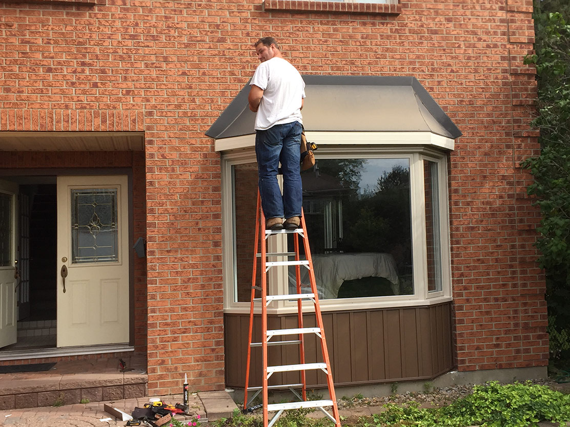 Installing window on red brick home
