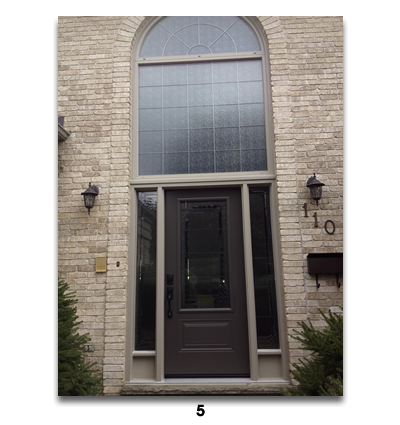 single brown door with lare top area