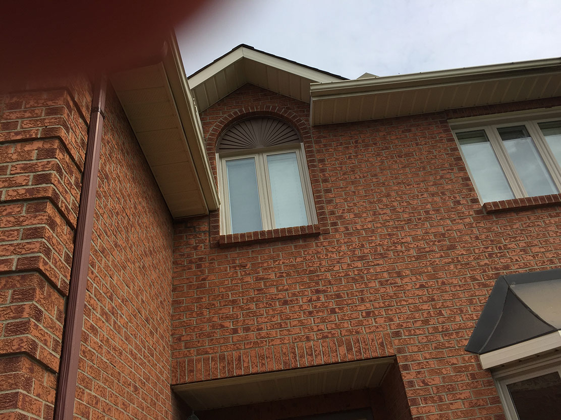 windows on red brick home
